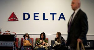 Passengers wait for flights in the Delta Air Lines Inc. terminal at LaGuardia Airport (LGA) in New York, U.S., on Monday, Oct. 21, 2013. Delta Air Lines Inc. is scheduled to release earnings figures on Oct. 22. Photographer: Ron Antonelli/Bloomberg