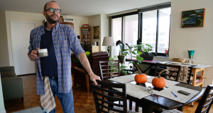 Jim Albaugh talks about his living arrangements in the New York apartment he shares with two roommates on Oct. 16. Albaugh could be thought of as just one of the working poor, untold millions in the baby boomer generation who are not prepared for retirement. But he represents something more as one of thousands of gay and lesbian baby boomers confronting a retirement of greater financial hardship than his straight peers. (AP Photo/Julie Jacobson)