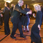 Armstrong Teasdale writer and editor Gail Appleson and her date,  Guillermo A. Rodríguez., dance to the Charles Glenn Band.