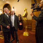 St. Louis divorce attorney Tom Lang, on left, and Dan Glazier, executive director of  Legal Services of Eastern Missouri, are interviewed by Wes Murrell of Coolfire Studios at the Justice For All Ball Saturday night. Lang is the originator of the event.
