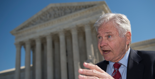 """Ben Jones, national spokesman for The Sons of Confederate Veterans, also a former Congressman from Georgia and """"Cooter"""" in the Dukes of Hazzard TV show, talks to reporters outside the Supreme Court in Washington on Monday after the Supreme Court heard arguments in Walker v. Sons of Confederate Vets case. (AP Photo/Molly Riley)"""