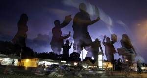 "In this Aug. 20, 2014 file photo taken with a long exposure, protesters march in the street as lightning flashes in the distance in Ferguson, Mo. The one year anniversary of the shooting of Michael Brown, which sparked months of nationwide protests and launched the ""Black Lives Matter"" movement, is on Sunday, Aug. 9, 2015. (AP Photo/Jeff Roberson, File)"