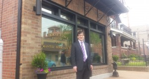 Gerard Mantese stands in front of his new law office in The Hill neighborhood in St. Louis. The building was the Michigan attorney's childhood home, and also served as a storefront for his father's electrical shop. Photo by Allyssa Dudley
