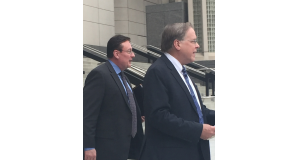 Mike Sanders, center, walks out of the Charles Evans Whittaker Courthouse in Kansas City Friday with attorney, J.R. Hobbs of Wyrsch Hobbs & Mirakian, right, after pleading guilty to one count of conspiracy to commit wire fraud. Photo by Jessica Shumaker