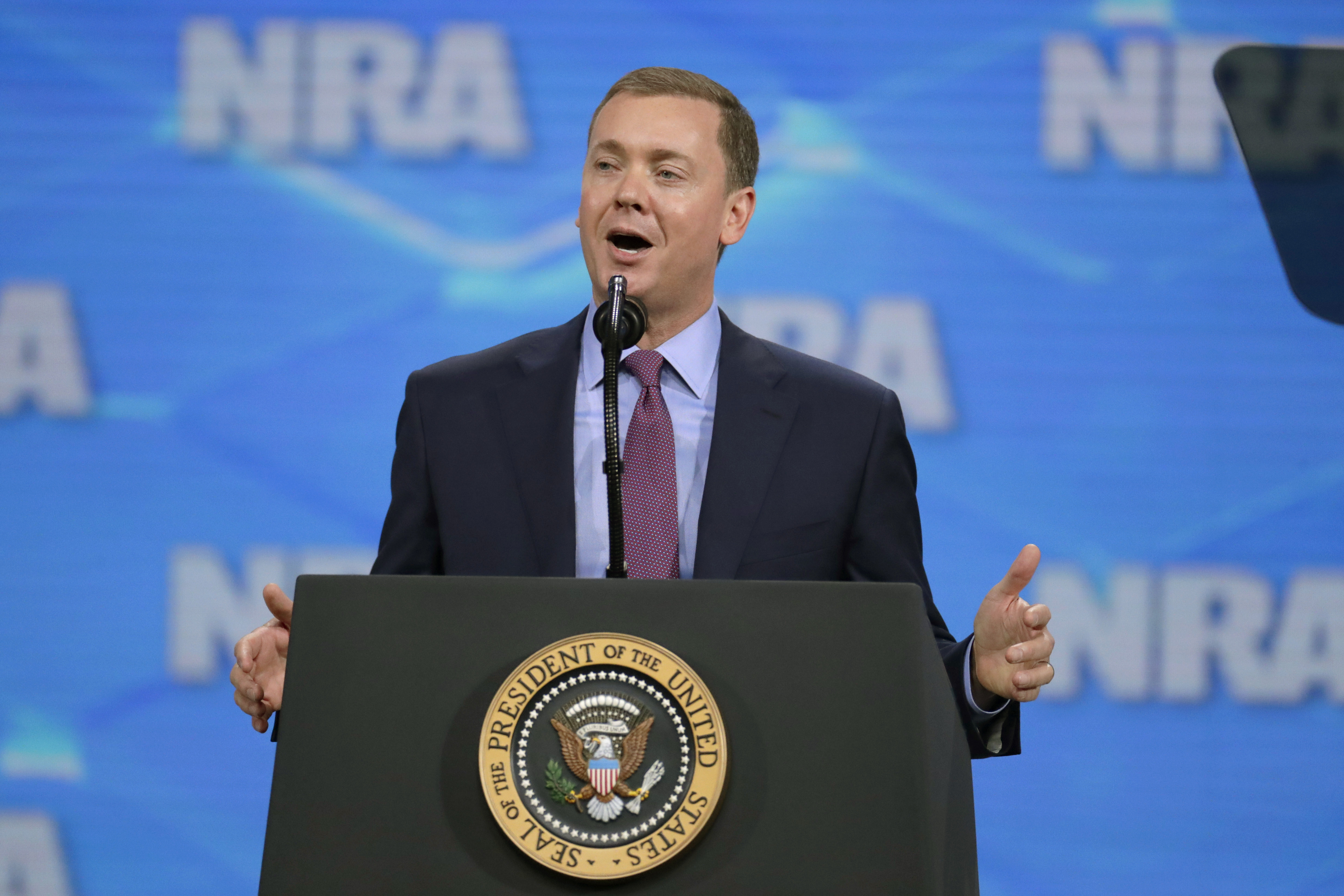 FILE- In this April 26, 2019 file photo, National Rifle Association Institute for Legislative Action Executive Director Christopher W. Cox speaks at the NRA-ILA Leadership Forum in Lucas Oil Stadium in Indianapolis. The National Rifle Association's top lobbyist has resigned in another sign of infighting within the powerful gun lobbying group, Wednesday, June 26, 2019. Cox's departure comes just days after the NRA placed him on administrative leave, claiming he was part of a failed attempt to extort the longtime CEO. (AP Photo/Michael Conroy, File)