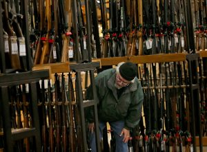 A man looks at the shotgun section of Cabela's while shopping on Black Friday in Hazelwood, Mo. The number of background checks conducted by federal authorities is on pace to break a record by the end of this year. Photo by Christian Gooden of the St. Louis Post-Dispatch via AP