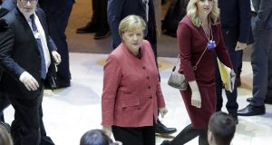 German Chancellor Angela Merkel, center, arrives Thursday at the World Economic Forum in Davos, Switzerland. The 50th annual meeting of the forum is taking place in Davos from Tuesday through Friday. AP Photo by Markus Schreiber