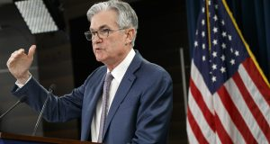 """Federal Reserve Chair Jerome Powell speaks during a news conference Tuesday to discuss an announcement from the Federal Open Market Committee in Washington. In a surprise move, the Federal Reserve cut its benchmark interest rate by a sizable half-percentage point in an effort to support the economy in the face of the spreading coronavirus. Chairman Jerome Powell noted that the coronavirus """"poses evolving risks to economic activity."""" AP Photo by Jacquelyn Martin"""
