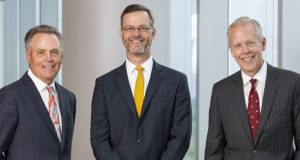 Armstrong Teasdale Chairman Emeritus Michael A. Chivell, Managing Partner Patrick W. Rasche and Chairman David W. Braswell. Submitted photo